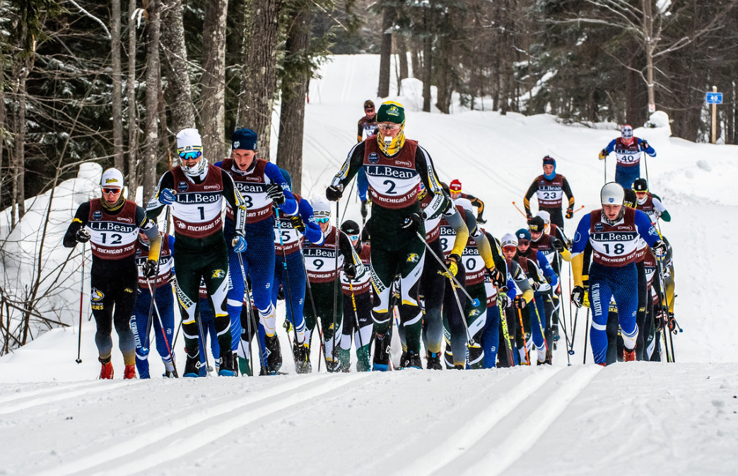 The men on the first uphill of the mass start